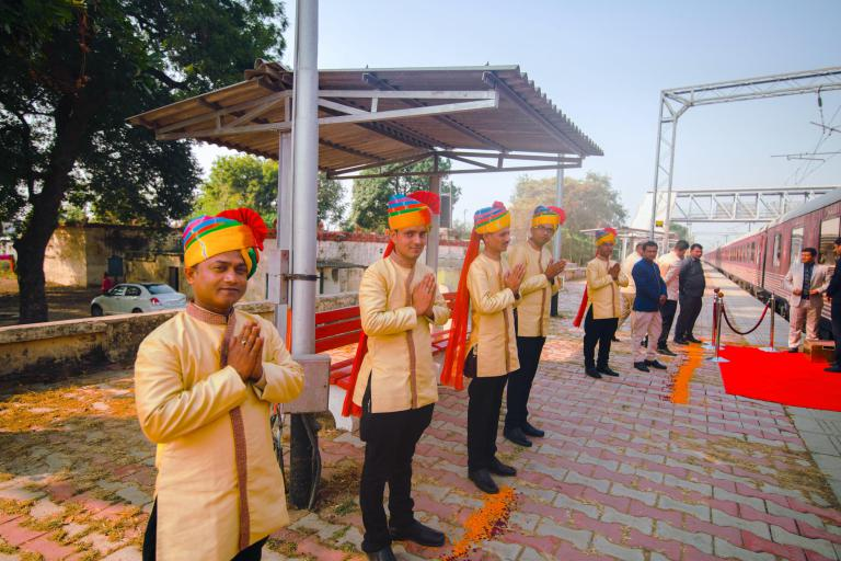 Maharajas Express train butlers outside
